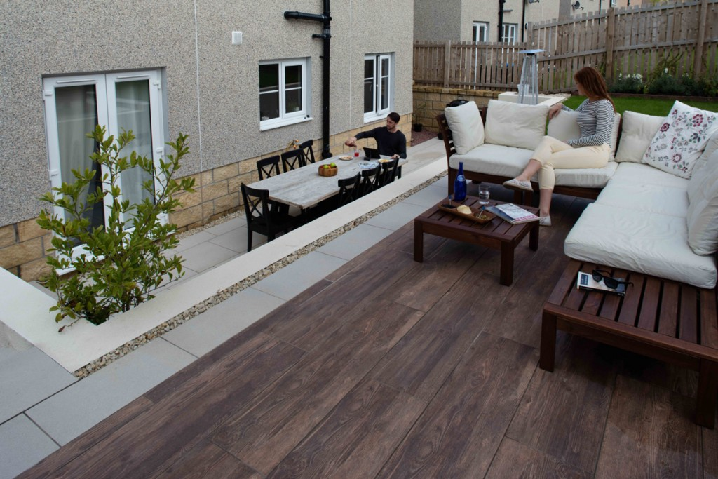 Patios, walling and steps by Stow Construction & Landscaping 2016 using Marshalls Symphony Vitrified paving Barley and Cherry, Fairstone Sawn Versuro walling Golden Sand Multi, K-Rend finish to walling Polar White.