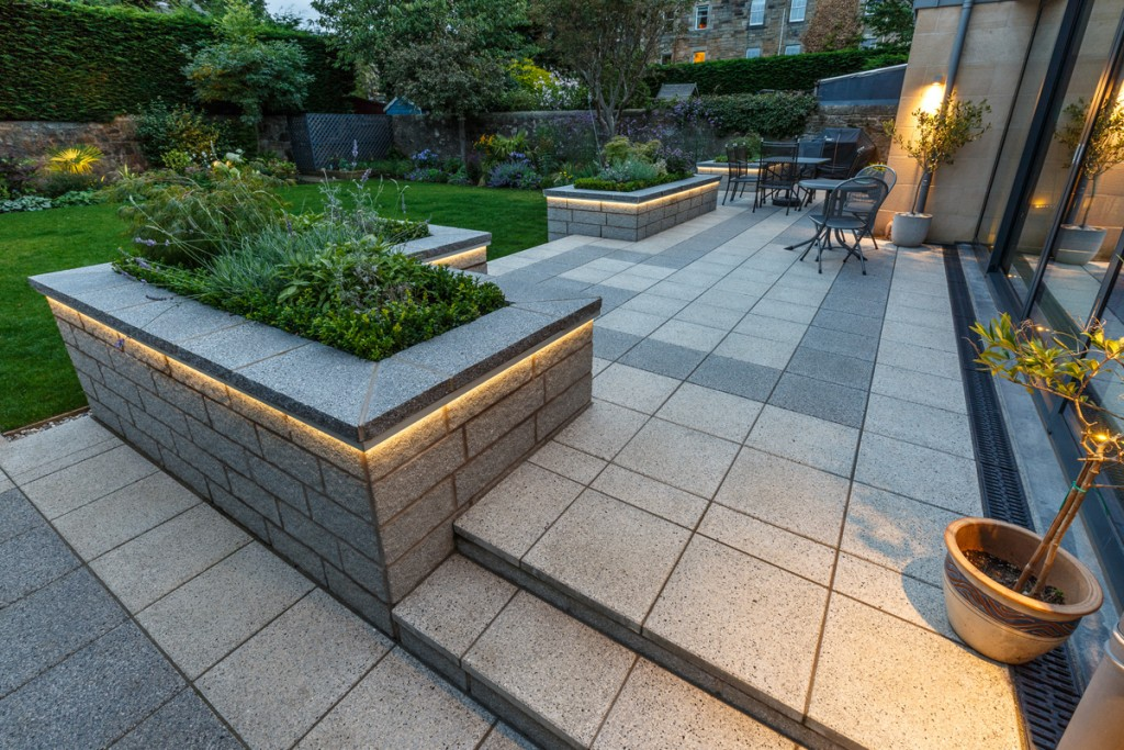 Patio, walling and steps by Stow Construction & Landscaping in Nile Grove, Edinburgh 2017 using Marshalls Argent walling Light, Argent Light & Dark Smooth, Argent coping dark. Garden lighting.