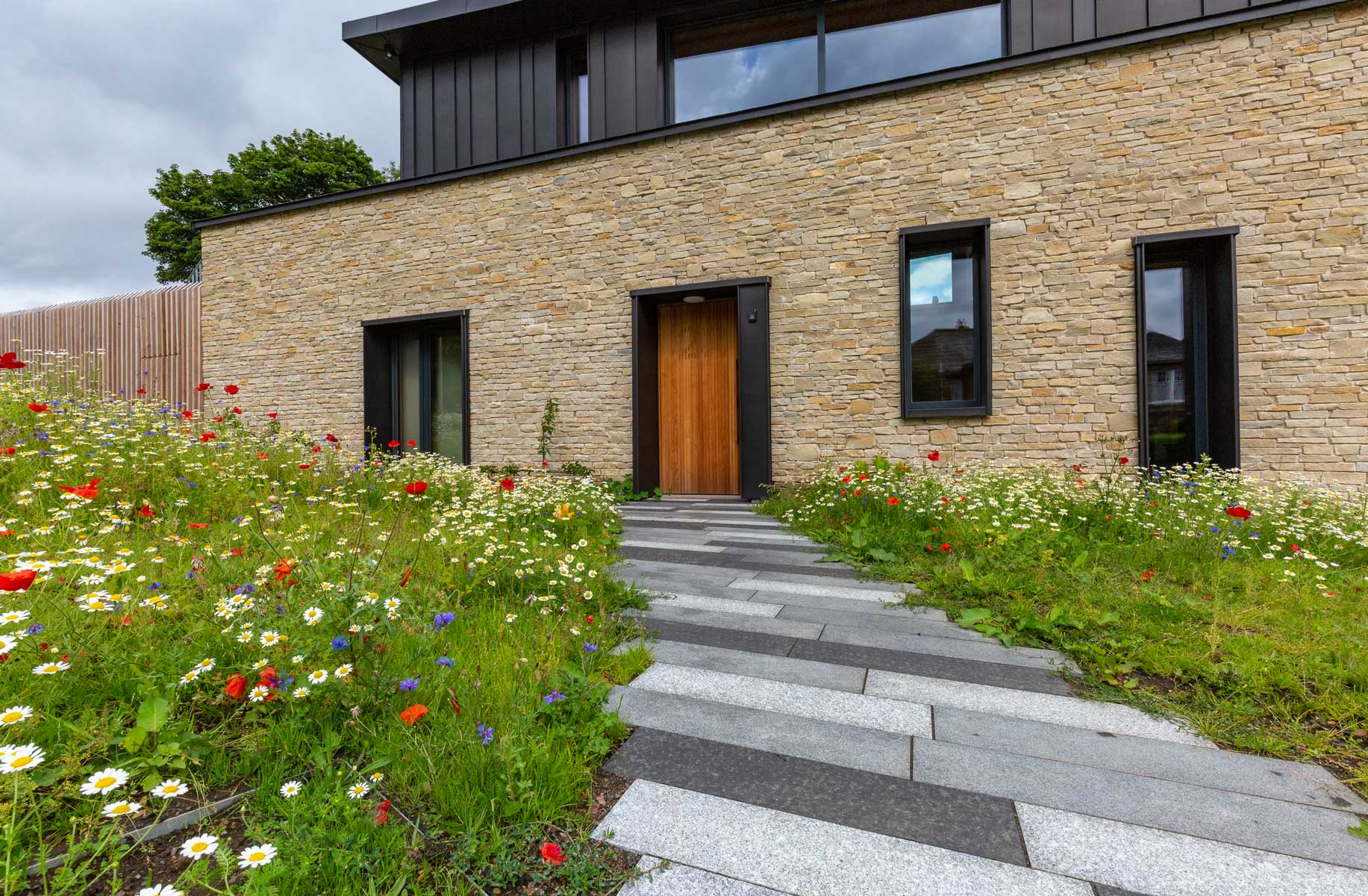 Garden design, landscaping, patio, paths & steps Observatory Road, Edinburgh 2018 using Marshalls Fairstone Granite Eclipse Light, Dark & Graphite, Marshalls Fairstone Granite Eclipse bull-nosed step units Dark, Marshalls Grassguard Earth Brown, wild flower meadow, Weatherpoint 365 Grey