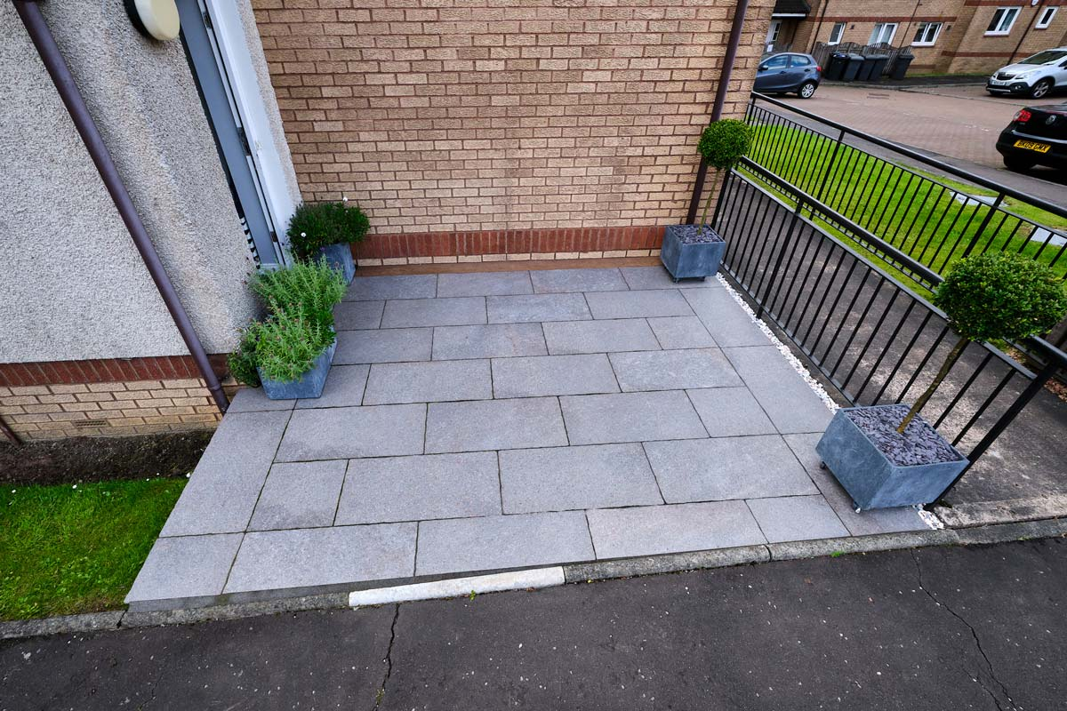 Small Patio designed and installed by Stow Construction & Landscaping, Marshalls Symphony Tumbled Rosso, Millboard decking, landscaping, paving, porcelain, designer, installer, Livingston