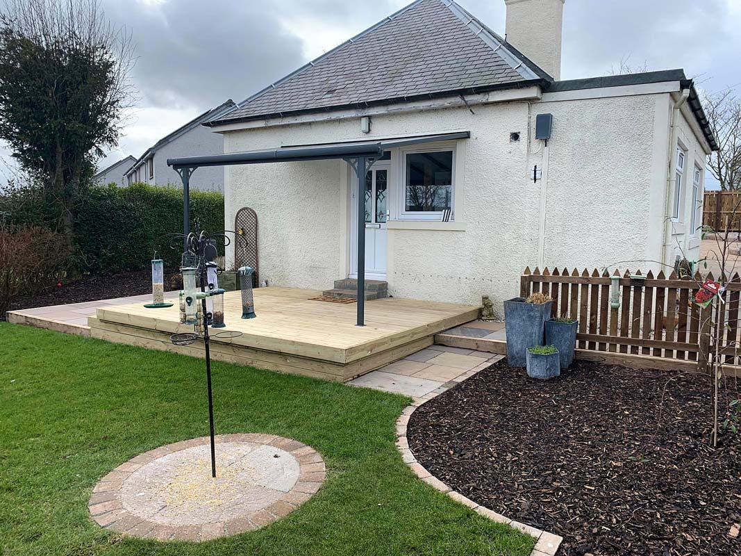 Decking, garden design, construction, awning, turfing, decorative edge detail, bark by Stow Construction and Landscaping in Gordon, Scottish Borders