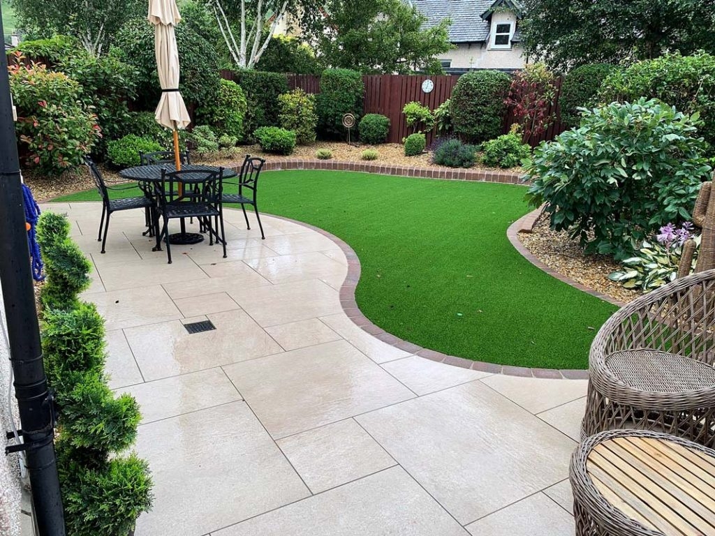 Patio, artificial grass, landscaping, kerbs and decorative edge detail by Stow Construction and Landscaping in Cardrona, Peebles, Scottish Borders 02